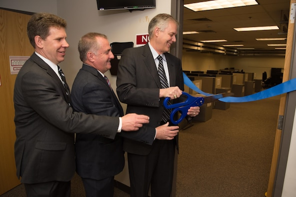 Glen Townsend, left, Engineering director for the Command, Control, Communications, Intelligence and Networks Directorate, Stephen Falcone Engineering Director for the Battle Management Directorate and Dennis Miller, AFLCMC-Hanscom's director of Engineering and Technical Management, officially open the Hanscom Engineering and Analysis Training Lab in the Hanscom Collaboration and Innovation Center May 1, 2017. The HEAT lab will give Airmen access to advanced networked computers loaded with high-end software. (U.S. Air Force photo by Jerry Saslav)