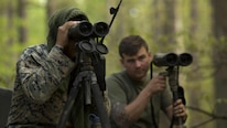 Marine instructors use binoculars to locate trainees during stalk training at Fort A.P. Hill, Va., April 26, 2017. Marines conducted the training in preparation for an upcoming deployment as a crisis response force. The Marines are with 2nd Battalion, 2nd Marine Regiment.