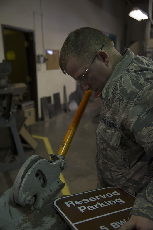 Staff Sgt. Horace Hand, 5th Civil Engineer Squadron structural craftsman, shapes a sign at the sign shop on Minot Air Force Base, N.D., April 27, 2017. The sign shop produces about 20-25 signs per week. (U.S. Air Force photo/Airman 1st Class Dillon Audit)