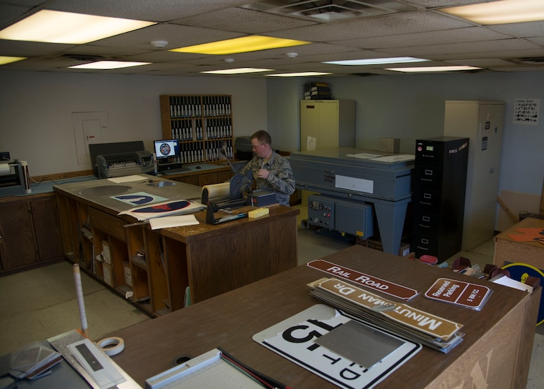 Staff Sgt. Horace Hand, 5th Civil Engineer Squadron structural craftsman, organizes signs at the sign shop on Minot Air Force Base, N.D., April 27, 2017. The sign shop maintains all government signs on base and within the missile complex. (U.S. Air Force photo/Airman 1st Class Dillon Audit)