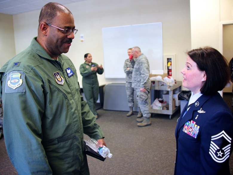 Vice commander of the 932nd Airlift Wing, Col. Esteban Ramirez, congratulates newly promoted Senior Master Sgt. Tonya Hupp, and her new role with the 932nd Aeromedical Evacuation Squadron on May 7, 2017, at Scott Air Force Base, Illinois.  She will now be the operations superintendent of the squadron, which falls under the 932nd Operations Group.   (U.S. Air Force photo by Lt. Col. Stan Paregien)