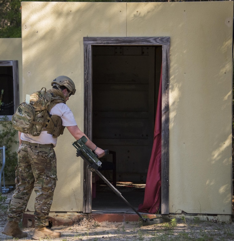Staff Sgt. Justin Gardner, 788th Civil Engineer Squadron, Explosive Ordnance Disposal Flight, Wright Patterson Air Force Base, Ohio, sweeps the front of a building for improvised explosive devices during the EOD Warfighter Challenge at Eglin AFB, Fla. The challenge was a four-day, scenario-based, skills exchange between 17 EOD teams from across the Air Force. (U.S. Air Force photo/Cheryl Sawyers)