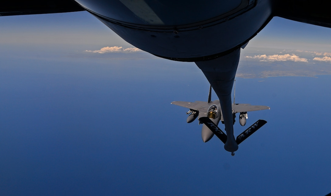 A U.S. Air Force F-15E Strike Eagle prepares to receive fuel from a KC-135 Stratotanker May 3, 2017. Each of the low-drag conformal fuel tanks that hug the F-15E's fuselage can carry 750 gallons of fuel. The tanks hold weapons on short pylons rather than conventional weapon racks, reducing drag and further extending the range of the Strike Eagle. (U.S. Air Force photo by Staff Sgt. Micaiah Anthony)