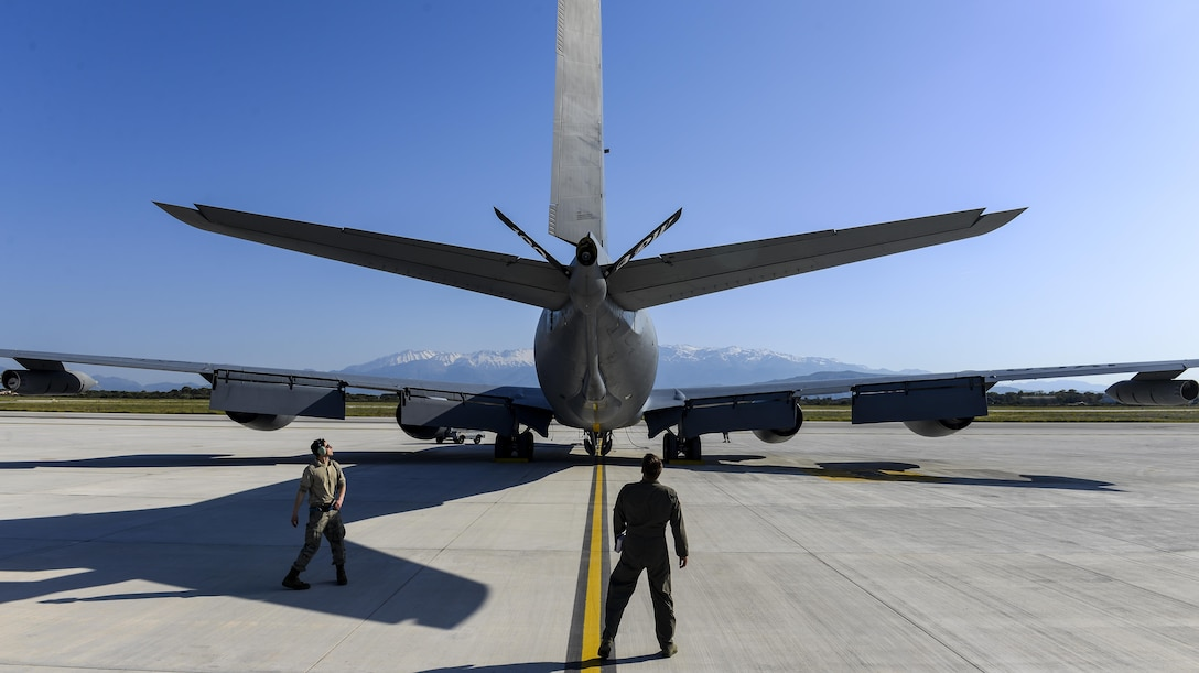 U.S. Air Force Capt. Bobby Stanford, 351st Air Refueling Squadron mission commander, and U.S. Air Force Staff Sgt. Joseph Flores, 100th Aircraft Maintenance Squadron flying crew chief, inspect a KC-135 Stratotanker May 3, 2017, at Naval Support Activity Souda Bay, Greece. As the mission commander, Stanford was in charge of two other aircraft during the refueling mission. (U.S. Air Force photo by Staff Sgt. Micaiah Anthony)