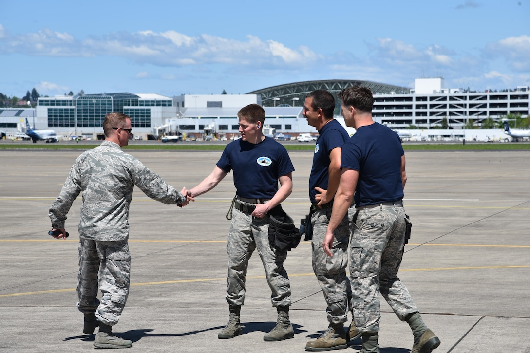The winning team of Oregon Air National Guard's 142nd Aircraft Maintenance Squadron, aircraft armament ordinance journeymen, are congratulated by Col. Christopher Lantagne, 142nd Maintenance Group Commander, left,  following an F-15 Eagle weapons load competition, May 7, 2017, Portland Air National Guard Base, Ore. (U.S. Air National Guard photo by Tech. Sgt. Aaron Perkins, 142nd Fighter Wing Public Affairs)