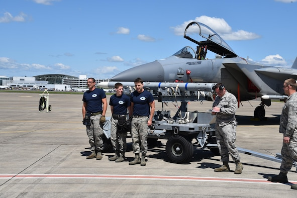 Oregon Air National Guard's 142nd Aircraft Maintenance Squadron, aircraft armament ordinance journeymen, participate in a F-15 Eagle weapons load contest to see which team can properly and safely load six missiles onto three separate aircraft, May 7, 2017, Portland Air National Guard Base, Ore. (U.S. Air National Guard photo by Tech. Sgt. Aaron Perkins, 142nd Fighter Wing Public Affairs)