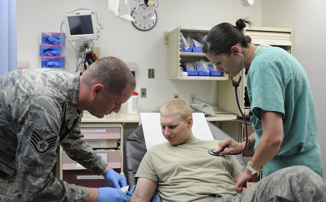 U.S. Air Force Staff Sgt. Andrew Day, 366th Medical Operations Squadron aerospace medicine technician and 1st Lt. Stephanie Doane, 366th MDOS clinical nurse, care for a patient at Mountain Home Air Force Base, Idaho. Primary care physicians, nurses and medical technicians make up the core team under Air Force Medical Home care model, and are joined by specialty care providers when needed.