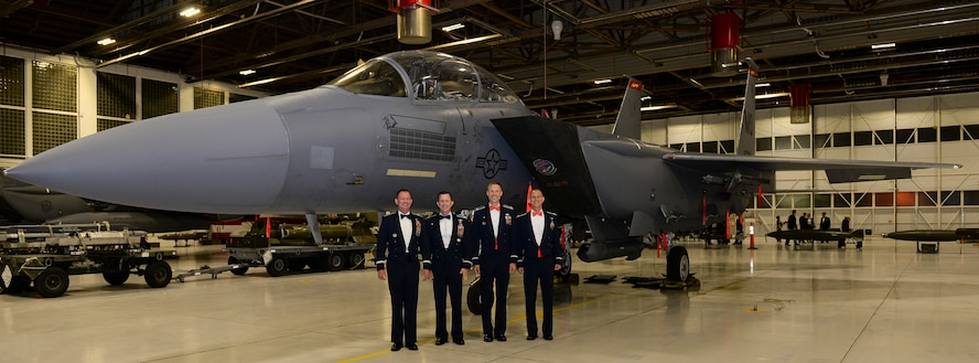 Air Combat Command Inspector General, Brig. Gen. Richard Coe, poses in front of a F-15E Strike Eagle with fellow T-Bolt members, May 6, 2017, at Mountain Home Air Force Base, Idaho. Coe served as the base's first Strike Eagle commander almost 10 years ago. (U.S. Air Force photo by Senior Airman Jessica H. Smith/Released)