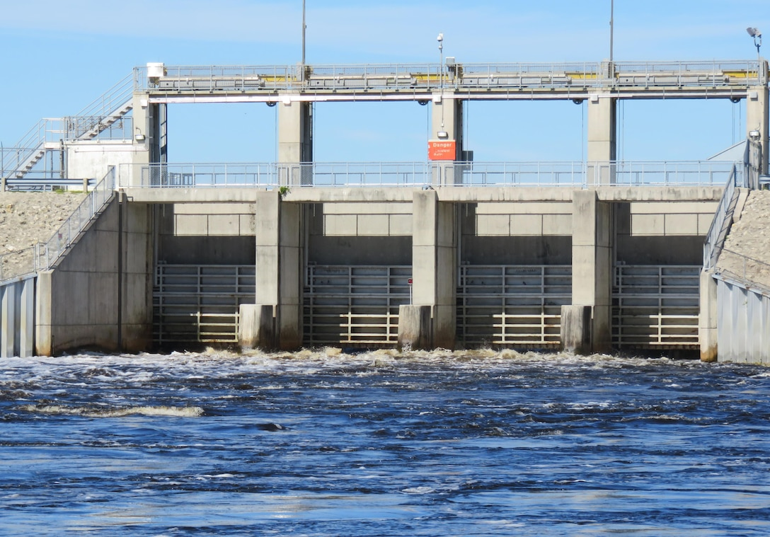 Water flows through the spillway gates at Moore Haven Lock & Dam in early 2016.  The U.S. Army Corps of Engineers has seen water levels in Lake Okeechobee go from one extreme to the other over the past year.