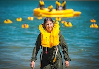 Lt. Col. Debbie Deja, 433rd Aeromedical Evacuation Squadron director of operations, emerges from the water after finishing life raft training May 5, 2017 at Joint Base San Antonio-Canyon Lake. The triannual training is a requirement for all aircrew Air Force Specialty Codes and includes open water swimming and life raft training. (U.S. Air Force photo by Benjamin Faske)