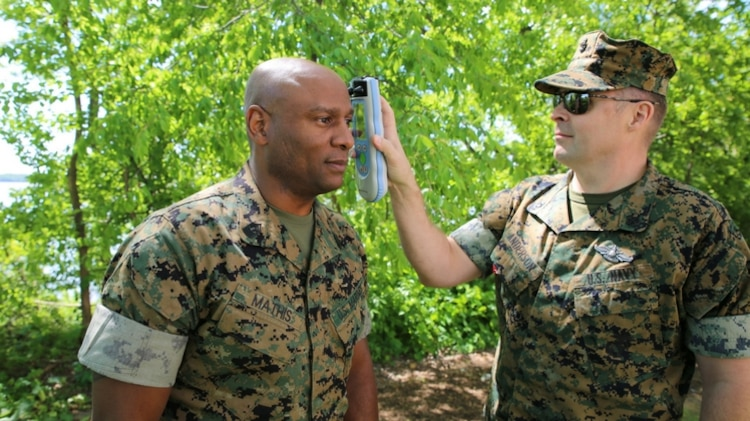 Chief Hospital Corpsman Jared Anderson uses an Infrascanner to assess Master Gunnery Sgt. Maceo Mathis for intracranial hematomas--or bleeding within the skull--aboard Marine Corps Base Quantico, Va. The Infrascanner is a portable, medical diagnostic device that provides early detection of intracranial hematomas in the field, potentially saving lives and improving casualty care and recovery. Infrascanners are available for medical personnel to use at battalion aid stations across the Corps.  (U.S. Marine Corps photo by Ashley Calingo)