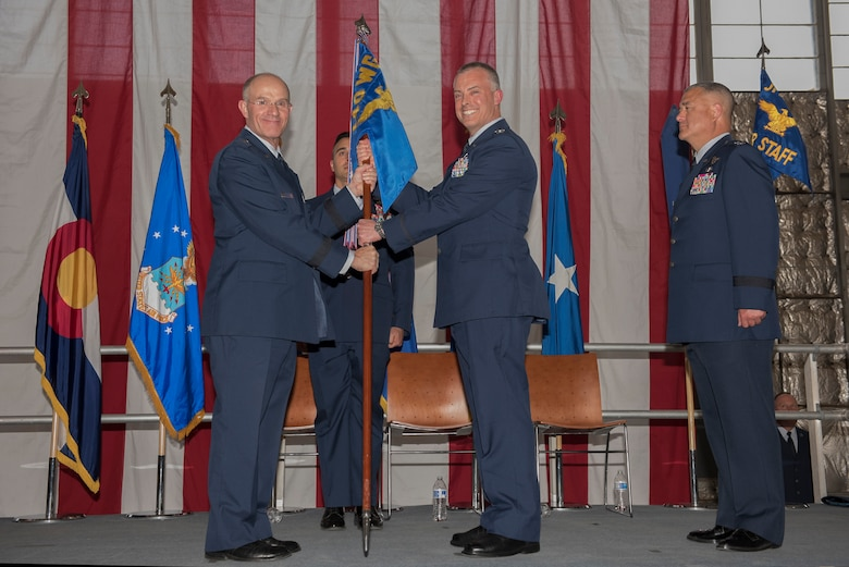 Air Force Brig. Gen. Jerome Limoge, Assistant Adjutant General - Air, Colorado National Guard, presents the guidon to Col. Brian Turner, as he assumes command of the 140th Wing, Colorado Air National Guard, May 6, 2017, Buckley Air Force Base, Aurora, Colo. The change of command ceremony is a deeply rooted military tradition that represents the formal transfer of authority and responsibility for a unit from one commanding officer to another.  (U.S. Air National Guard photo by Staff Sgt. Michelle Y. Alvarez-Rea)