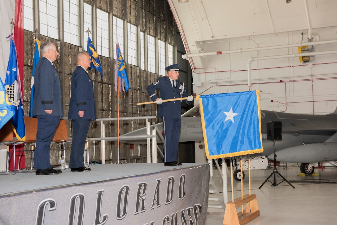 Air Force Maj. Gen. Michael Edwards, Adjutant General for the state of Colorado and Brig. Gen. Floyd Dunstan, Assistant Adjutant General, Colorado Air National Guard, stand at attention as the general officer flag is presented to Dunstan during his promotion to Brigadier General, May 6, 2017, Buckley Air Force Base, Aurora, Colo. Upon promotion to the general officer ranks, it is customary to receive a personal flag, representing authority and/or command.  (U.S. Air National Guard photo by Staff Sgt. Michelle Y. Alvarez-Rea)
