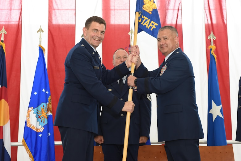 Air Force Maj. Gen. Michael Loh, Adjutant General for the state of Colorado, presents the guidon to Brig. Gen. Floyd Dunstan, as he assumes command of the Colorado Air National Guard as the Assistant Adjutant General, May 6, 2017, Buckley Air Force Base, Aurora, Colo. The change of command ceremony is a deeply rooted military tradition that represents the formal transfer of authority and responsibility for a unit from one commanding officer to another.  (U.S. Air National Guard photo by Staff Sgt. Michelle Y. Alvarez-Rea)