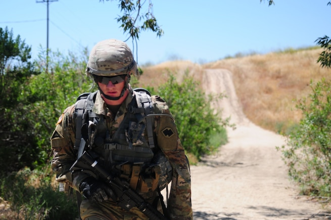 Sgt. Brandon Blue, a horizontal construction engineer with the 786th Quartermaster Company, conducts a 6.2-mile ruck march during the Best Warrior Competition hosted by the 79th Sustainment Support Command at Camp Pendleton, Calif., May 4, 2017. 