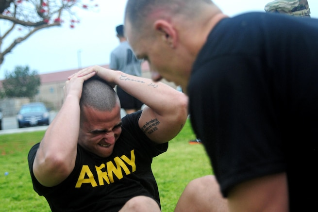 Sgt. Carlos Garcia Velasquez, a human resources specialist with the 90th Sustainment Brigade, conducts sit-ups during the Best Warrior Competition hosted by the 79th SSC at Camp Pendleton, Calif., May 4, 2017. 