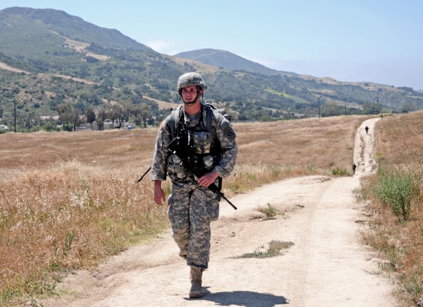 Spc. Mitchell Willyard, a human resources specialist with the 620th Combat Sustainment Support Battalion, conducts a 6.2-mile ruck march during the Best Warrior Competition hosted by the 79th SSC at Camp Pendleton, Calif., May 4, 2017. 