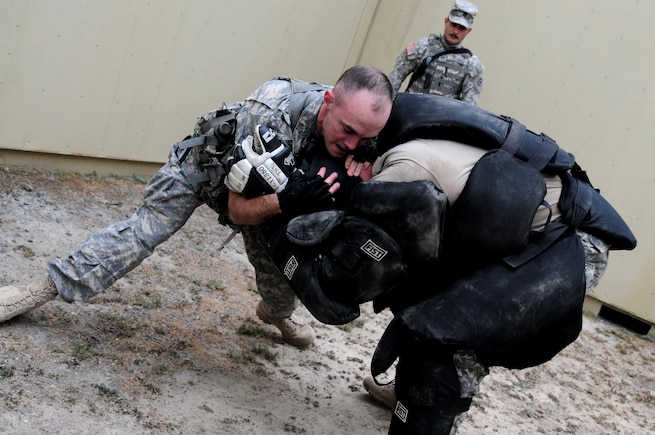 """Spc. Justin Rafferty, a petroleum supply specialist with the 910th Quartermaster Company, subdues a """"high value target"""" during the Best Warrior Competition hosted by the 79th SSC at Camp Pendleton, Calif., May 5, 2017.   The U.S. Army Reserve's 79th Sustainment Support Command hosted their 2017 Best Warrior Competition at Camp Pendleton, Calif., May 3-6. The Best Warrior Competition seeks out the best candidate that defines a U.S. Army Soldier by testing Soldiers physically and mentally. The competition consisted of one enlisted Soldier and one noncommissioned officer from four separate one-star commands, which fall underneath the command and control of 79th SSC. At the conclusion, one Soldier and one NCO were named the 79th SSC Best Warriors and will represent the command in the U.S. Army Reserve Best Warrior Competition held at Fort Bragg, N.C., June 4-10, 2017. (U.S. Army photo by Sgt. Heather Doppke/released)"""