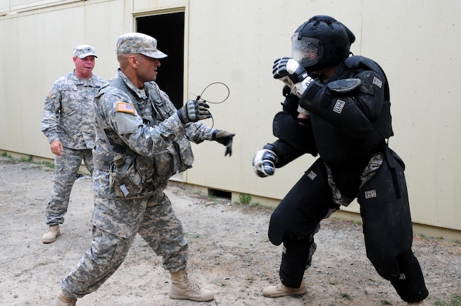 """Sgt. Felix Garcia, a financial management technician with the 311th Expeditionary Sustainment Command, subdues a """"high value target"""" during the Best Warrior Competition hosted by the 79th SSC at Camp Pendleton, Calif., May 5, 2017.   The U.S. Army Reserve's 79th Sustainment Support Command hosted their 2017 Best Warrior Competition at Camp Pendleton, Calif., May 3-6. The Best Warrior Competition seeks out the best candidate that defines a U.S. Army Soldier by testing Soldiers physically and mentally. The competition consisted of one enlisted Soldier and one noncommissioned officer from four separate one-star commands, which fall underneath the command and control of 79th SSC. At the conclusion, one Soldier and one NCO were named the 79th SSC Best Warriors and will represent the command in the U.S. Army Reserve Best Warrior Competition held at Fort Bragg, N.C., June 4-10, 2017. (U.S. Army photo by Sgt. Heather Doppke/released)"""