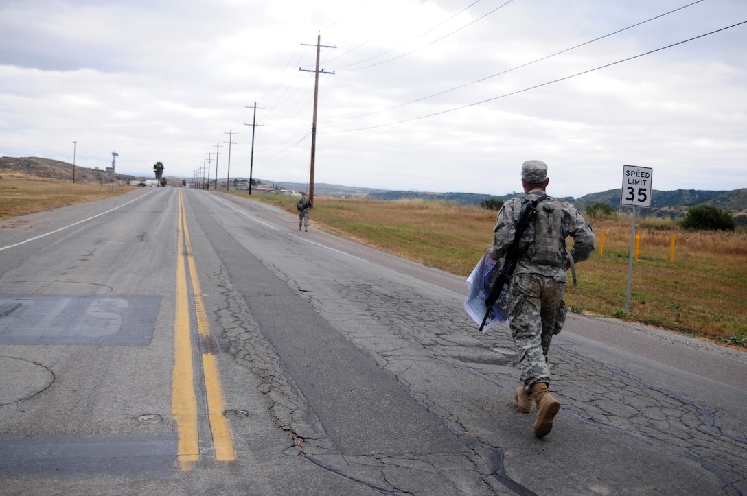 Spc. Kenny Ochoa, a watercraft operator with the 481st Transportation Company, runs down the road during the Land Navigation Course portion of the Best Warrior Competition hosted by the 79th SSC at Camp Pendleton, Calif., May 6, 2017.   The U.S. Army Reserve's 79th Sustainment Support Command hosted their 2017 Best Warrior Competition at Camp Pendleton, Calif., May 3-6. The Best Warrior Competition seeks out the best candidate that defines a U.S. Army Soldier by testing Soldiers physically and mentally. The competition consisted of one enlisted Soldier and one noncommissioned officer from four separate one-star commands, which fall underneath the command and control of 79th SSC. At the conclusion, Ochoa was named one of the 79th SSC Best Warriors and will represent the command in the U.S. Army Reserve Best Warrior Competition held at Fort Bragg, N.C., June 4-10, 2017. (U.S. Army photo by Sgt. Heather Doppke/released)