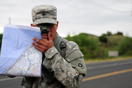 Spc. Kenny Ochoa, a watercraft operator with the 481st Transportation Company, shoots his azimuth during the Land Navigation Course portion of the Best Warrior Competition hosted by the 79th SSC at Camp Pendleton, Calif., May 6, 2017.   The U.S. Army Reserve's 79th Sustainment Support Command hosted their 2017 Best Warrior Competition at Camp Pendleton, Calif., May 3-6. The Best Warrior Competition seeks out the best candidate that defines a U.S. Army Soldier by testing Soldiers physically and mentally. The competition consisted of one enlisted Soldier and one noncommissioned officer from four separate one-star commands, which fall underneath the command and control of 79th SSC. At the conclusion, Ochoa was named one of the 79th SSC Best Warriors and will represent the command in the U.S. Army Reserve Best Warrior Competition held at Fort Bragg, N.C., June 4-10, 2017. (U.S. Army photo by Sgt. Heather Doppke/released)