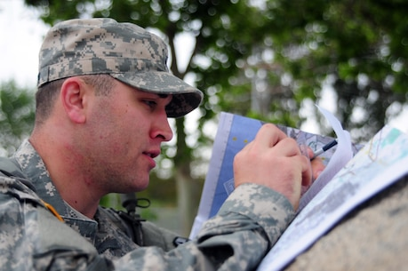 Spc. Daniel Kovitch, a motor transport operator with the 364th Expeditionary Sustainment Command, plots points on a map during the Land Navigation Course portion of the Best Warrior Competition hosted by the 79th SSC at Camp Pendleton, Calif., May 6, 2017.   The U.S. Army Reserve's 79th Sustainment Support Command hosted their 2017 Best Warrior Competition at Camp Pendleton, Calif., May 3-6. The Best Warrior Competition seeks out the best candidate that defines a U.S. Army Soldier by testing Soldiers physically and mentally. The competition consisted of one enlisted Soldier and one noncommissioned officer from four separate one-star commands, which fall underneath the command and control of 79th SSC. At the conclusion, one Soldier and one NCO were named the 79th SSC Best Warriors and will represent the command in the U.S. Army Reserve Best Warrior Competition held at Fort Bragg, N.C., June 4-10, 2017. (U.S. Army photo by Sgt. Heather Doppke/released)
