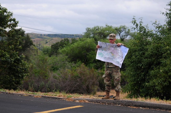 Sgt. Carlos Garcia Velasquez, a human resources specialist with the 90th Sustainment Brigade, looks at a map during the Land Navigation Course portion of the Best Warrior Competition hosted by the 79th SSC at Camp Pendleton, Calif., May 6, 2017. 