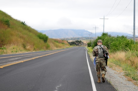 Sgt. Carlos Garcia Velasquez, a human resources specialist with the 90th Sustainment Brigade, hikes down a road during the Land Navigation Course portion of the Best Warrior Competition hosted by the 79th SSC at Camp Pendleton, Calif., May 6, 2017.  The U.S. Army Reserve's 79th Sustainment Support Command hosted their 2017 Best Warrior Competition at Camp Pendleton, Calif., May 3-6. The Best Warrior Competition seeks out the best candidate that defines a U.S. Army Soldier by testing Soldiers physically and mentally. The competition consisted of one enlisted Soldier and one noncommissioned officer from four separate one-star commands, which fall underneath the command and control of 79th SSC. At the conclusion, one Soldier and one NCO were named the 79th SSC Best Warriors and will represent the command in the U.S. Army Reserve Best Warrior Competition held at Fort Bragg, N.C., June 4-10, 2017. (U.S. Army photo by Sgt. Heather Doppke/released)