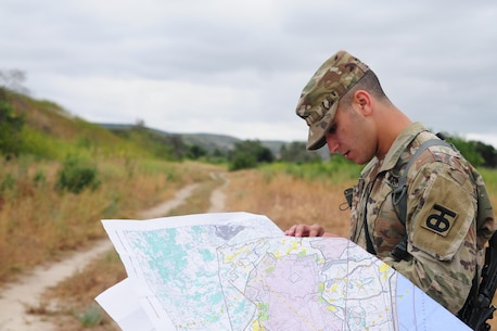 Sgt. Carlos Garcia Velasquez, a human resources specialist with the 90th Sustainment Brigade, looks at a map during the Land Navigation Course portion of the Best Warrior Competition hosted by the 79th SSC at Camp Pendleton, Calif., May 6, 2017.   The U.S. Army Reserve's 79th Sustainment Support Command hosted their 2017 Best Warrior Competition at Camp Pendleton, Calif., May 3-6. The Best Warrior Competition seeks out the best candidate that defines a U.S. Army Soldier by testing Soldiers physically and mentally. The competition consisted of one enlisted Soldier and one noncommissioned officer from four separate one-star commands, which fall underneath the command and control of 79th SSC. At the conclusion, one Soldier and one NCO were named the 79th SSC Best Warriors and will represent the command in the U.S. Army Reserve Best Warrior Competition held at Fort Bragg, N.C., June 4-10, 2017. (U.S. Army photo by Sgt. Heather Doppke/released)