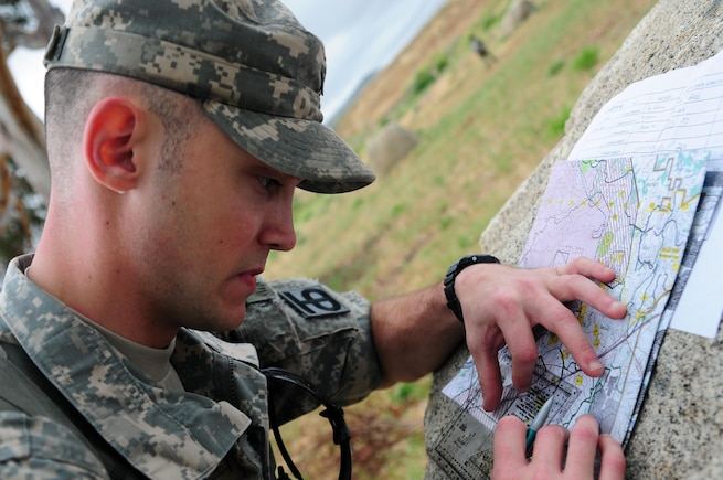 Spc. Justin Rafferty, a petroleum supply specialist with the 910th Quartermaster Company, plot points on a map during the Land Navigation Course portion of the Best Warrior Competition hosted by the 79th SSC at Camp Pendleton, Calif., May 6, 2017. 