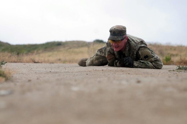 Sgt. Brandon Blue, a horizontal construction engineer with the 786th Quartermaster Company, high crawls during the 5k challenge event of the Best Warrior Competition hosted by the 79th SSC at Camp Pendleton, Calif., May 6, 2017. 