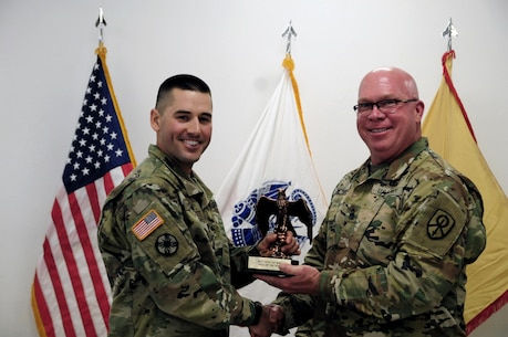Staff Sgt. Kenneth Chefan, a transportation management coordinator with the 535th Movement Control Team, is awarded by Command Sgt. Maj. Donald E. Langworthy II, interim command sergeant major of the 79th Sustainment Support, during the BWC's closing ceremony hosted by the 79th SSC at Camp Pendleton, Calif., May 6, 2017.  The U.S. Army Reserve's 79th Sustainment Support Command hosted their 2017 Best Warrior Competition at Camp Pendleton, Calif., May 3-6. The Best Warrior Competition seeks out the best candidate that defines a U.S. Army Soldier by testing Soldiers physically and mentally. The competition consisted of one enlisted Soldier and one noncommissioned officer from four separate one-star commands, which fall underneath the command and control of 79th SSC. At the conclusion, Chefan was named one of the 79th SSC Best Warriors and will represent the command in the U.S. Army Reserve Best Warrior Competition held at Fort Bragg, N.C., June 4-10, 2017. (U.S. Army photo by Sgt. Heather Doppke/released)