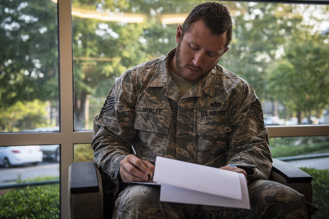 Staff Sgt. Nicholas Worley, 23d Civil Engineer Squadron electrical systems craftsman, fills out paperwork before a doctor's appointment, April 18, 2017, in Valdosta, Ga. In January 2012 Worley was diagnosed with Chronic Myelogenous Leukemia, an uncommon form of blood-cell cancer that starts in the blood-forming bone marrow cells. He's currently in remission and goes to the cancer center every three months to ensure his treatment is still working. (U.S. Air Force Photo by Senior Airman Janiqua P. Robinson)