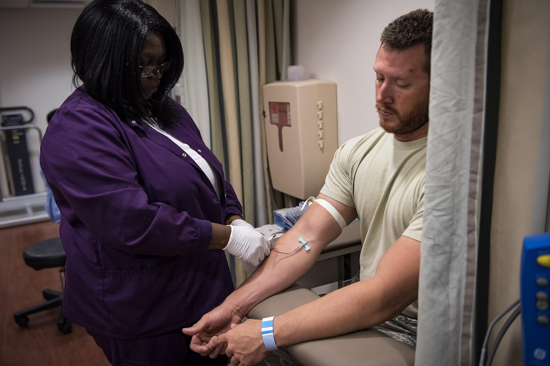 A medical assistant draws blood from Staff Sgt. Nicholas Worley, 23d Civil Engineer Squadron electrical systems craftsman, during an appointment, April 18, 2017, in Valdosta, Ga. In January 2012 Worley was diagnosed with Chronic Myelogenous Leukemia, an uncommon form of blood-cell cancer that starts in the blood-forming bone marrow cells. He's currently in remission and goes to the cancer center every three months to ensure his treatment is still working. (U.S. Air Force Photo by Senior Airman Janiqua P. Robinson)