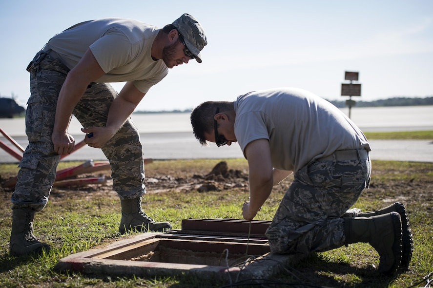 Staff Sgt. Nicholas Worley, 23d Civil Engineer Squadron electrical systems craftsman, walks Senior Airman Pablo Castillo, 23d CES electrical systems journeyman, through the process it takes to remark wires, April 13, 2017, at Moody Air Force Base, Ga. In January 2012, Worley was diagnosed with Chronic Myelogenous Leukemia, an uncommon form of blood-cell cancer that starts in the blood-forming bone marrow cells. He's currently in remission and goes to the cancer center every three months to ensure his treatment is still working. (U.S. Air Force Photo by Senior Airman Janiqua P. Robinson)