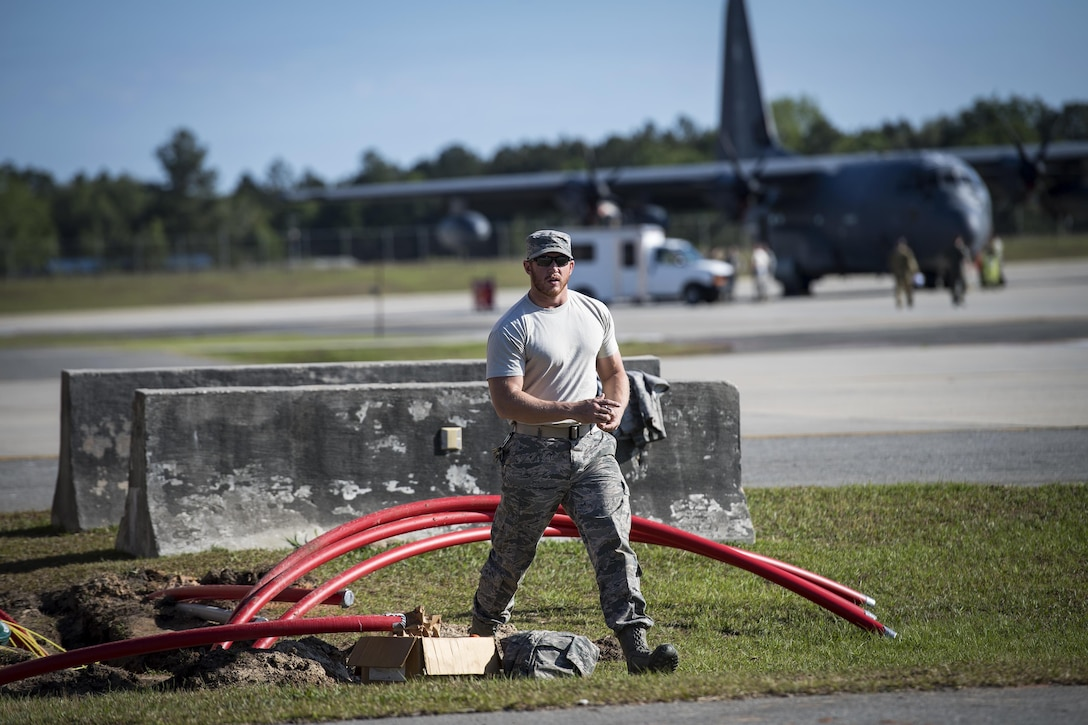 Staff Sgt. Nicholas Worley, 23d Civil Engineer Squadron electrical systems craftsman, walks across the flightline after remarking wires, April 13, 2017, at Moody Air Force Base, Ga. In January 2012, Worley was diagnosed with Chronic Myelogenous Leukemia, an uncommon form of blood-cell cancer that starts in the blood-forming bone marrow cells. He's currently in remission and goes to the cancer center every three months to ensure his treatment is still working. (U.S. Air Force Photo by Senior Airman Janiqua P. Robinson)