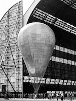 "Pictured is the Goodyear Zeppelin Corporation's three million cubic foot balloon, which was the largest balloon ever made. Maj. William Kepner was appointed to pilot the craft. Capt. Albert Stevens and Capt. Orvil Anderson accompanied him as the alternate pilot and organizer of the expedition camp dubbed the ""Stratobowl."""