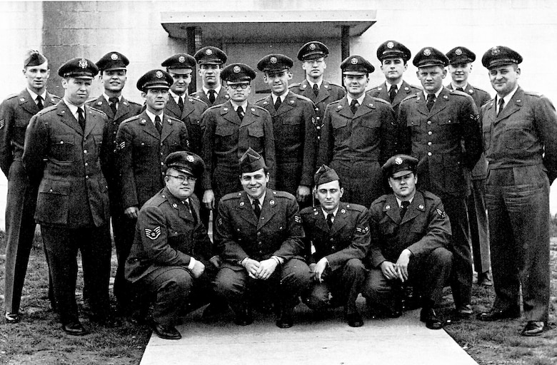 "Radar operators pose for a photo in 1953 at the Belleville Air Force Station at Turkey Hill, Belleville. These Airmen were assigned to the 798th Aircraft Control and Warning Squadron, which was responsible for monitoring the skies for hostile airborne objects in the metro-east, including the St. Louis metropolitan area. These particular Airmen were tasked with continuous detection, identification, and monitoring of aircraft. The call sign they used to communicate with F-86 pilots at Scott Air Force Base and with other air defense centers was ""Agony,"" so named as to be random for security and reporting purposes."