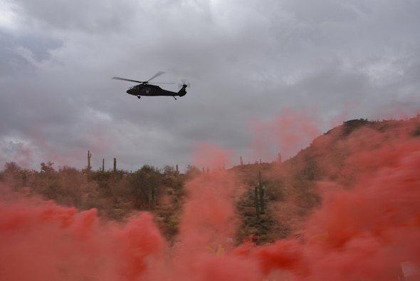 Day-time signal flares are used by aircrew to vector in a UH-60 Blackhawk during a simulated rescue at Lake Pleasant aquatic center, Ariz., May 7, 2017. Water survival training is conducted every two years at the 161st Air Refueling Wing to refresh the aircrew on using the life support equipment on board the aircraft in the event of an emergency. (U.S. Air Force photo by Tech. Sgt. Michael Matkin)