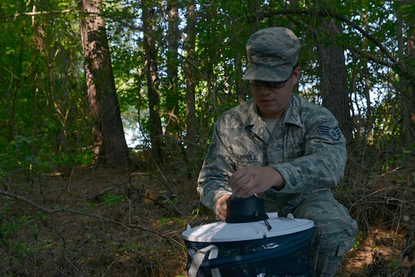 U.S. Air Force Staff Sgt. Michael Chapell, 20th Aerospace Medicine Squadron community health noncommissioned officer in charge, sets up a mosquito trap at Shaw Air Force Base, S.C., May 9, 2017. The mosquito trap will attract and contain insects, which the public health flight will then send to be tested for various diseases such as West Nile Virus and Zika. (U.S. Air Force photo by Airman 1st Class Destinee Sweeney)