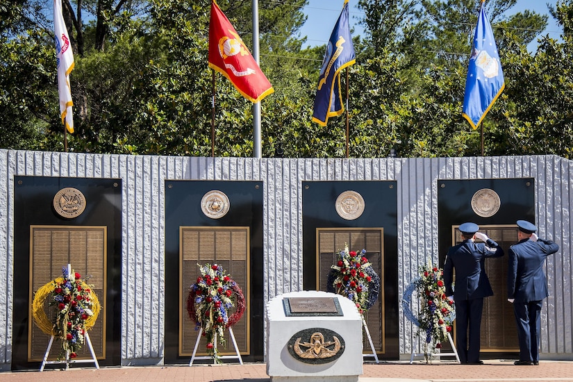 Chief Master Sgt. Martin Cortez and Lt. Col. Emil Rebik salute the list of fallen Air Force explosive ordnance disposal technicians during the 48th Annual EOD Memorial Service at the Kauffman EOD Training Complex on Eglin Air Force Base, Fla., May 6, 2017. Air Force photo by Samuel King Jr.