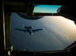 An Air Force A-10 Thunderbolt II departs after receiving fuel from a 340th Expeditionary Air Refueling Squadron KC-135 Stratotanker during a flight in support of Operation Inherent Resolve, April 27, 2017. The KC-135 provides aerial refueling capabilities as it supports U.S. and coalition forces as they work to liberate territory and people under the control of the Islamic State of Iraq and Syria. Air Force photo by Staff Sgt. Michael Battles