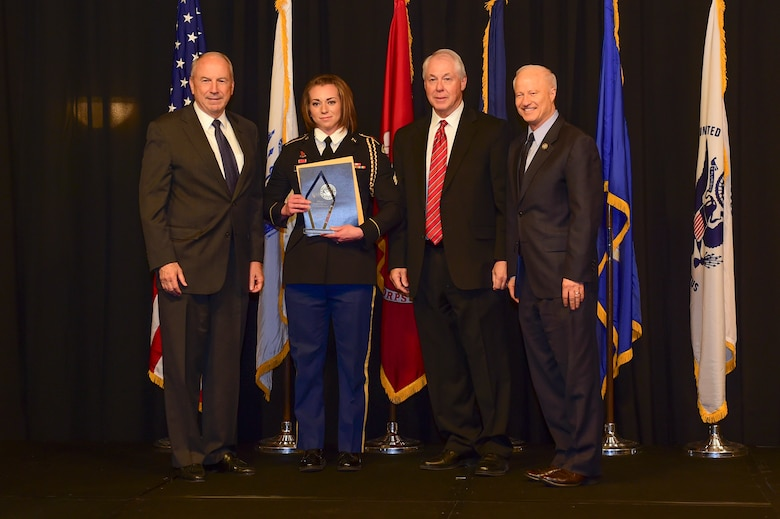 Army Sgt. Chloe Olson is awarded the Colorado National Guard Soldier of the year at the Armed Forces Recognition Luncheon May 5, 2017, at the DoubleTree by Hilton in Denver. The AFRL is an annual event hosted by the Aurora Chamber of Commerce in appreciation of Colorado's active-duty, guardsmen and reservists. (U.S. Air Force photo by Airman Jacob Deatherage/Released)