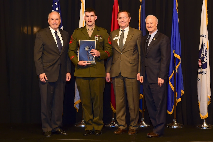 Sgt. Ray Gregory is awarded the active-duty Marine of the year at the Armed Forces Recognition Luncheon May 5, 2017, at the DoubleTree by Hilton in Denver. The AFRL is an annual event hosted by the Aurora Chamber of Commerce in appreciation of Colorado's active-duty, guardsmen and reservists. (U.S. Air Force photo by Airman Jacob Deatherage/Released)