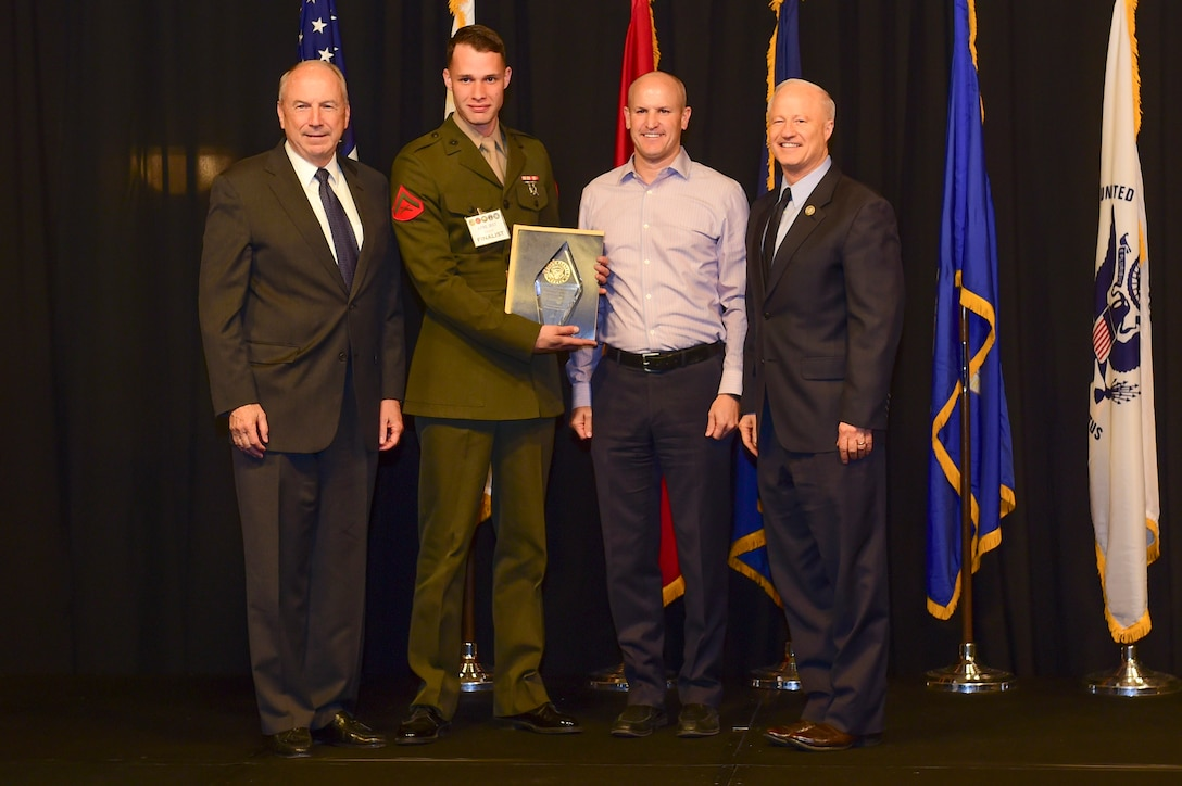 Lance Cpl. Matthew Nahmensen is awarded the Marine reservist of the year at the Armed Forces Recognition Luncheon May 5, 2017, at the DoubleTree by Hilton in Denver. The AFRL is an annual event hosted by the Aurora Chamber of Commerce in appreciation of Colorado's active-duty, guardsmen and reservists. (U.S. Air Force photo by Airman Jacob Deatherage/Released)