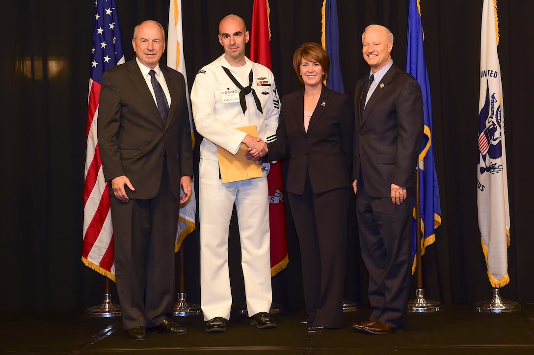 Petty Officer 1st Class Toby Gallt is awarded the active-duty Sailor of the year at the Armed Forces Recognition Luncheon May 5, 2017, at the DoubleTree by Hilton in Denver. The AFRL is an annual event hosted by the Aurora Chamber of Commerce in appreciation of Colorado's active-duty, guardsmen and reservists. (U.S. Air Force photo by Airman Jacob Deatherage/Released)