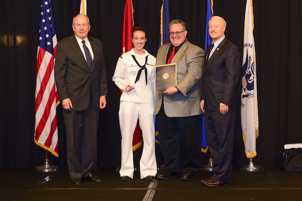 Petty Officer 3rd Class Marley Shafer is awarded the reservist Sailor of the year at the Armed Forces Recognition Luncheon May 5, 2017, at the DoubleTree by Hilton in Denver. The AFRL is an annual event hosted by the Aurora Chamber of Commerce in appreciation of Colorado's active-duty, guardsmen and reservists. (U.S. Air Force photo by Airman Jacob Deatherage/Released)