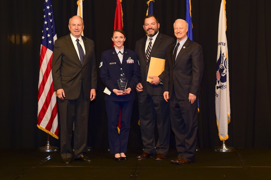 Tech. Sgt. Cassidy Wong is awarded the active-duty Airman of the year at the Armed Forces Recognition Luncheon May 5, 2017, at the DoubleTree by Hilton in Denver. The AFRL is an annual event hosted by the Aurora Chamber of Commerce in appreciation of Colorado's active-duty, guardsmen and reservists. (U.S. Air Force photo by Airman Jacob Deatherage/Released)