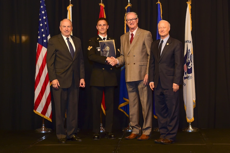 Master Seaman Ian McDonald is awarded the Commonwealth Partner of the year at the Armed Forces Recognition Luncheon May 5, 2017, at the DoubleTree by Hilton in Denver. The AFRL is an annual event hosted by the Aurora Chamber of Commerce in appreciation of Colorado's active-duty, guardsmen and reservists. (U.S. Air Force photo by Airman Jacob Deatherage/Released)