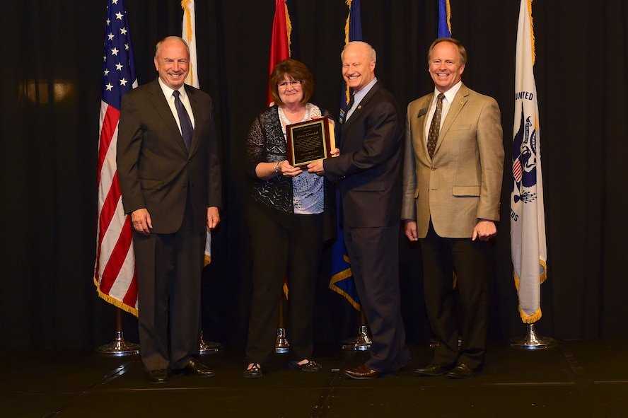 Diane Crandall is presented the Cardenas Award at the Armed Forces Recognition Luncheon May 5, 2017, at the DoubleTree by Hilton in Denver. The Cardenas Award is an award given to the year's outstanding military supporter. (U.S. Air Force photo by Airman Jacob Deatherage/Released)
